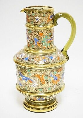 LARGE MOSER ENAMEL PITCHER IN GREEN WITH GOLD TRIM AND COLORFUL FLO... Lot 1179