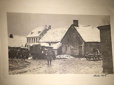 1915 WW1 SOLDIER WITH FOOD IN A SNOW COVERED BELGIUM VILLAGE
