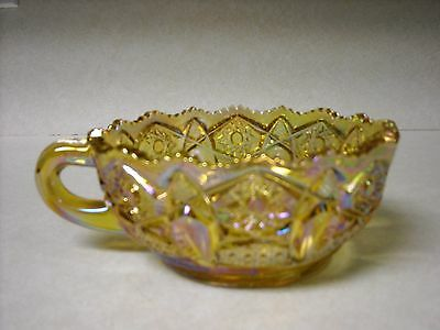 L E SMITH GOLD CARNIVAL GLASS HANDLED NAPPY