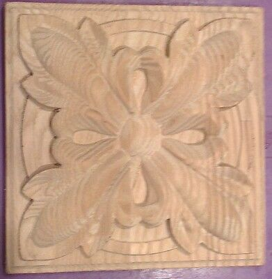 Carved out of wood decor element 100 * 100 * 20 mm.