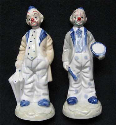 Set of two porcelain clown figurines, hand painted, with umbrella and drum