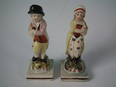 Pair Pearlware Staffordshire couple with cockerel figures