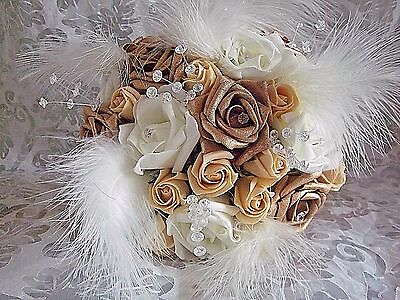 Gold champagne and ivory rose wedding bouquet diamantes, crystals and feathers.