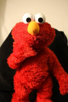 Talking Elmo Sings,Tells Stories, Jokes, Squeeze nose for honking sound, & more