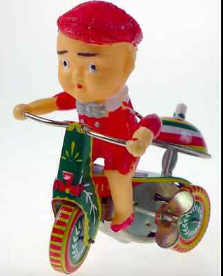 Boy On Ringing Tricycle  Wind Up Collectable