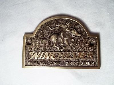 brass winchester rifles and shotguns gun store sign plaque with hores and rider