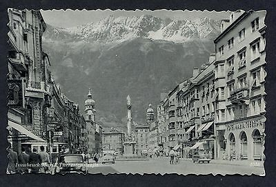View of People & Cars, Innsbruck, Austria. Posted 1955.