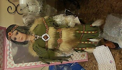 Native MJSA porcelain tribal doll with stand NEW IN BOX