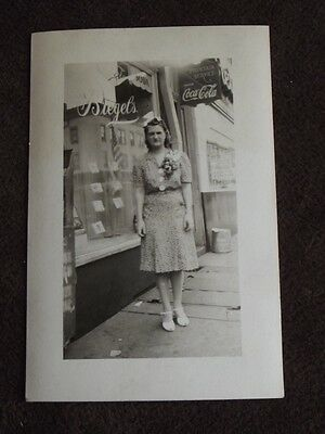 WOMAN IN FRONT OF BIEGEL'S STORE, COCA COLA SIGN IN BACKGROUND 1930's PHOTO