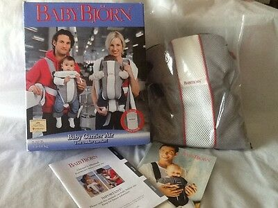 BabyBjorn Baby Carrier Air. The cooler carrier!!! New and Baby book!!