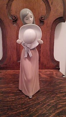 Lladro Figurine - Bashful Girl with Straw Hat. 5007