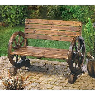 Rustic Wagon Wheel Bench with Country Charm. Weathered, antique look