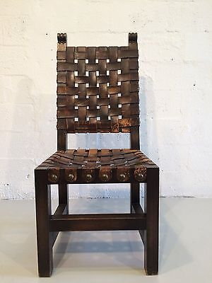 great spanish antique chair with leather straps and brass nailheads