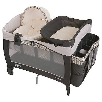 Graco® Pack'N Play® Playard with Newborn Napper® Elite Bassine...