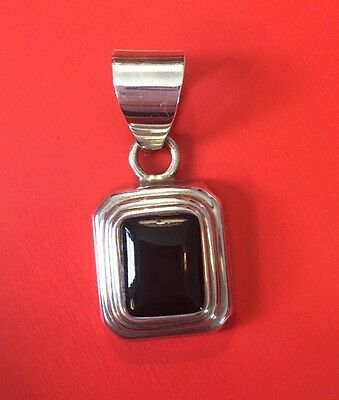 Silpada s1215 small sterling silver faceted black onyx pendant silpada pendant 1 34 sterling silver framed black onyx rectangular s0113 aloadofball Images