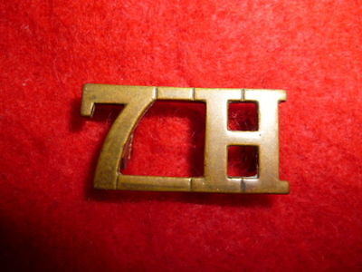 UK / GB - The 7th Hussars Brass Shoulder Title Badge