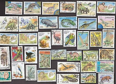 50 All Different PREHISTORIC & EXTINCT ANIMALS on Stamps