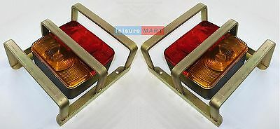 A pair of square four function trailer lights with heavy duty lamp guards