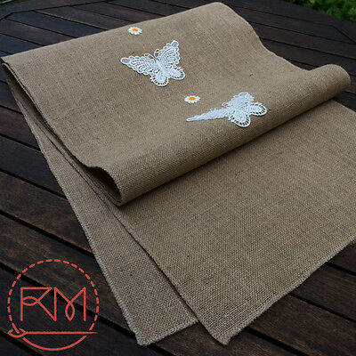 Table runner made from burlap hessian with butterfly and flower lace