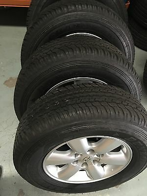 Toyota Hilux SR5 2010-2011 Genuine Alloy wheels with NEW Dunlop AT25 tyres
