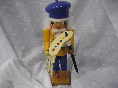 """Painted artist nut cracker with purple hat yellow jacket 10"""" tall"""