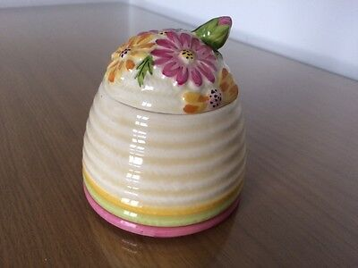 "Clarice Cliff, Large Beehive Honey Pot in ""Bizarre, Marguerite"" design c1934."