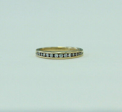 Estate Jewelery 14 K Yellow Gold Band Ring with 14 White Diamonds Set in Channel