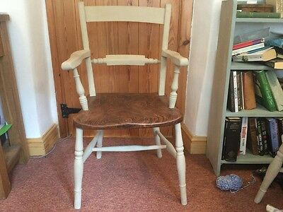 a pair of elm carver chairs