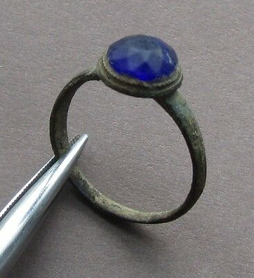 Ancient medieval bronze seal-ring on his finger!Glass blue insert!