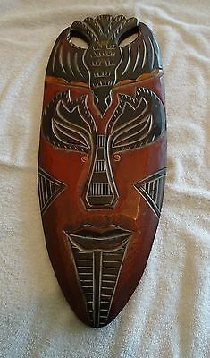 Large Wall Hanging Plaque of African or Asian Carved Wooden Mask