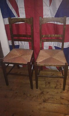A pair of chapel chairs church chairs rush seats kitchen chairs antique