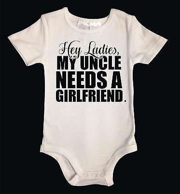 MY UNCLE NEEDS A GIRLFRIEND. White Cotton Unisex Baby One-Piece Funny