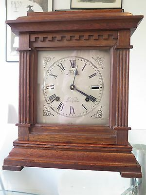 Super American Oak Mantle Clock with crenelated door by Ansonia Clock Company