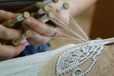 Set of Bobbin lace making. Bobbins,patterns,pins,crochet,pricker.