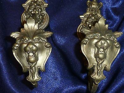 Pair of vintage French Curtain Tie Backs with lion faces.
