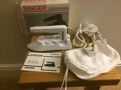 singer deluxe white steam travel iron dual voltage fold down handle