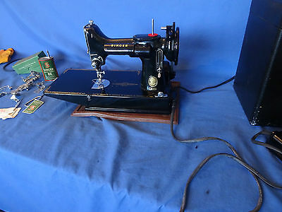 Singer 221K featherweight sewing machine with accessories