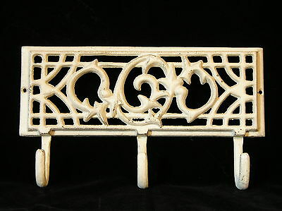 "Ornate Cast Iron Wall Mount Plaque< 3 Attached Hangers Painted Over 11"" x 6"""