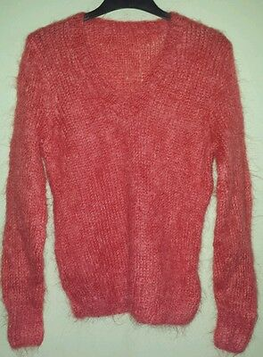 Vintage hand knitted mohair v-necked jumper in a coral/orange colour
