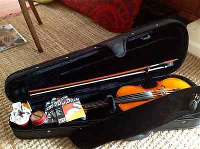 Full size violin hardly used dominant strings rosin and case.  Collection Herts