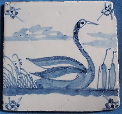 Blue and white antique Delft tile with a swan