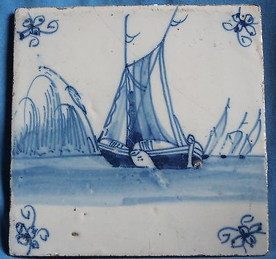 Blue and white antique Delft tile with a boat