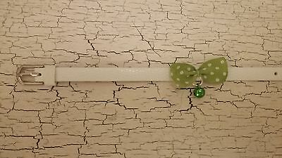hand crafted white kitten collar with green spotty bow