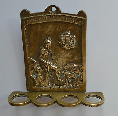 Old brass wall plaque depicting Bladud, the folklore founder of Bath