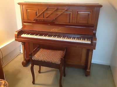 Upright Piano with Piano Stool.