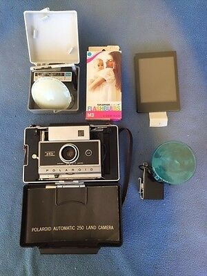 Polaroid Automatic 250 Land Camera with attachments and carrying case