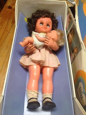 1950,s musical doll and baby in box