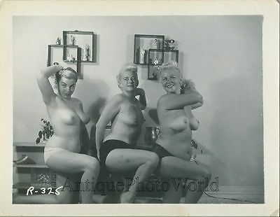 Three busty nude blonde women showing legs vintage pin-up photo
