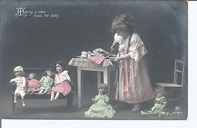 Vtg RPpc Young Girl with Dolls -  Making a new frock for Dolly pu 1913
