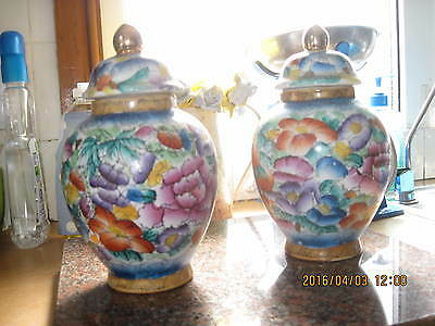 A Matching Pair Of Oriental Pattern Jars With Lids